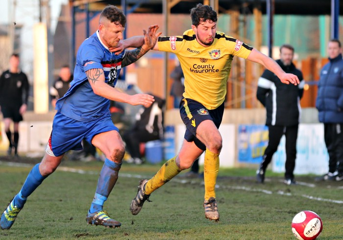 Harry Clayton eyes the ball under pressure in the second-half