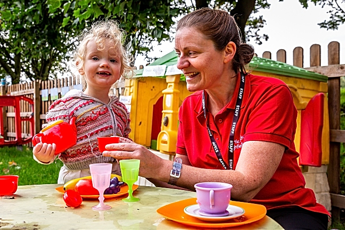 Highfield Academy - It's teatime with toddler Nancy Wise in the outdoor play kitchen