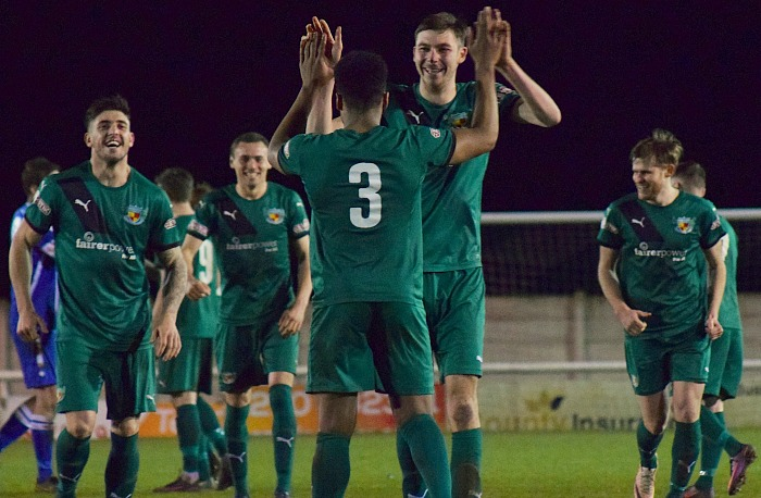 Ibou Touray celebrates his winning penalty goal with team mates - Nantwich reach Cheshire Senior Cup final