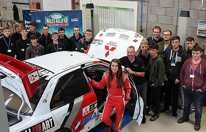 Jade Paveley rally car and students wide shot