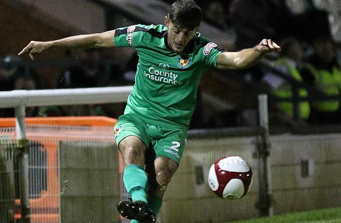 Jake Phillips crosses the ball into the danger area