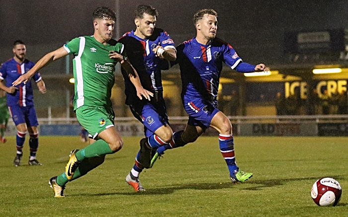 Jamie Morgan eyes the ball under pressure from Chasetown (1)