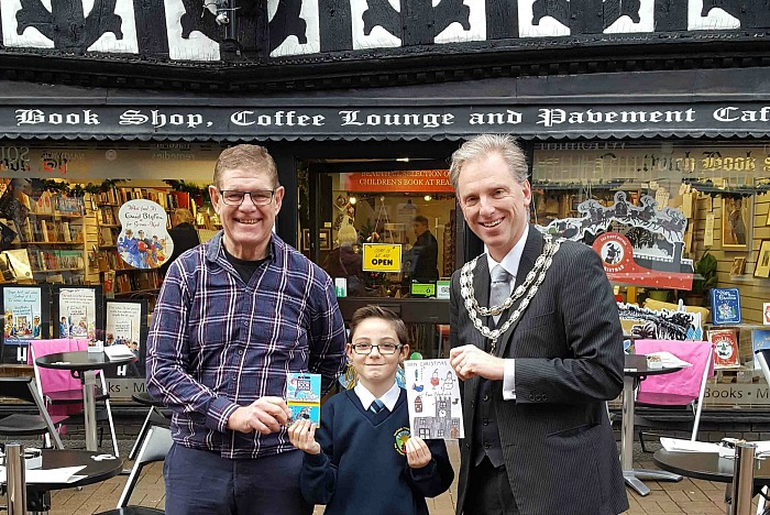 Jaymes, winner of Christmas Card competition, with Mayor Andrew Martin and Bookshop owner Steve Lawson