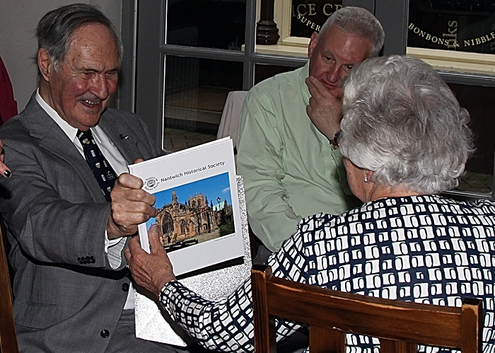 Jean Kay presents Herbert Rowsell and wife Jane with the commemorative book (1)