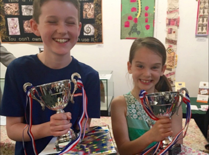 Jeremy Shorthose, Acton C of E Primary School and Handwriting Competition Jessica Martin, Stapeley Broad Lane CE Primary School winners at nantwich museum