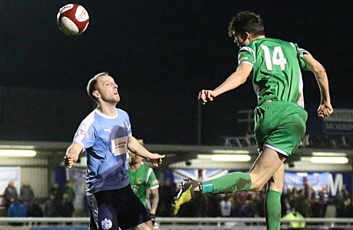 Joe Malkin heads the ball into the opposition box (1)