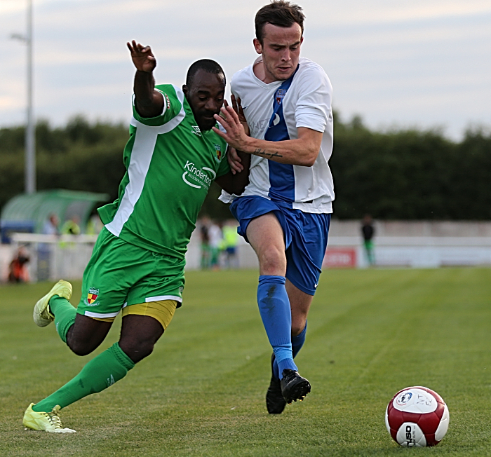 Joe Mwasile challenges for the ball (2)