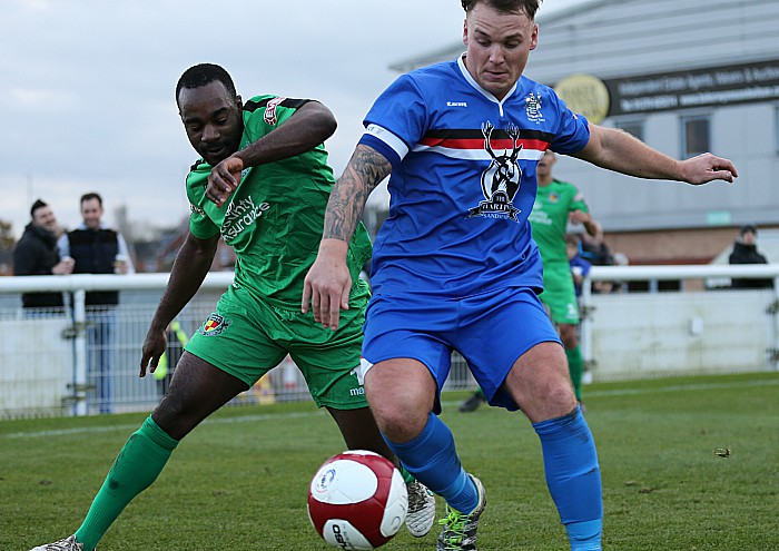 Joe Mwasile challenges for the ball