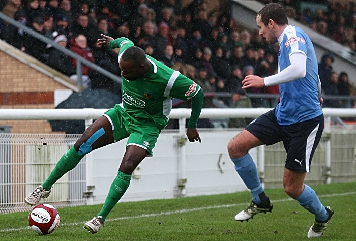 Joe Mwasile controls the ball under pressure from South Shields in the rain at the Weaver Stadium (1)