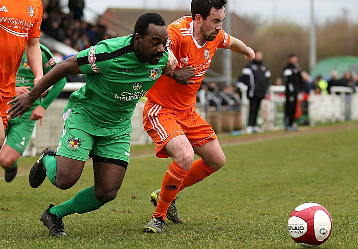 Joe Mwasile fights for the ball