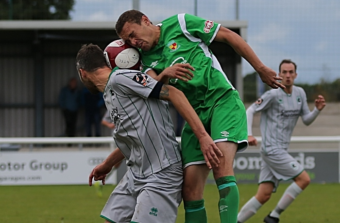 Joel Stair fights for the ball with Blyth captain Robbie Dale (1)