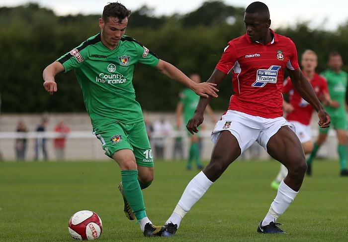 Jordan Davies holds off a Wrexham player