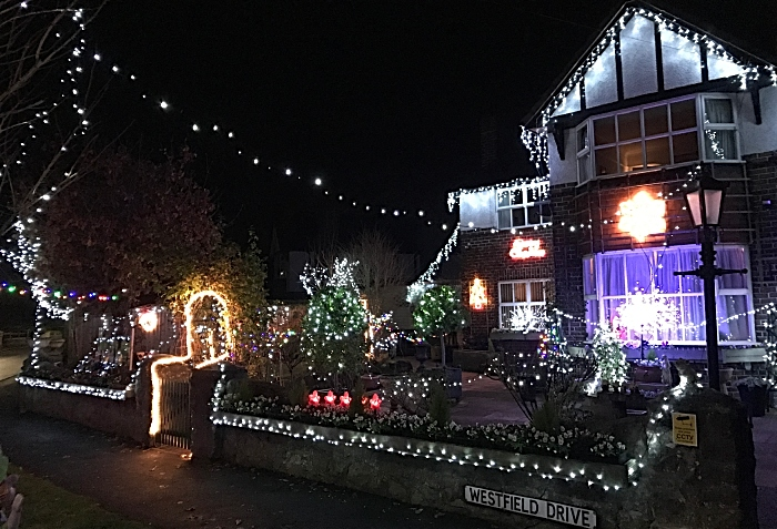 Laurence Perrys home lit up at nighttime (2)