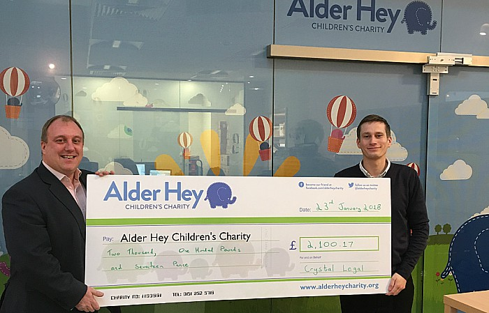 Left, Tony Shields MD of Crystal Legal hands the cheque over to Allan Eves from Alder Hey