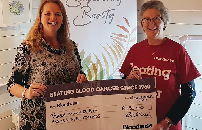 Liz Parkin - left - from Bluebell Beauty presents the cheque to Liz Boffey from Bloodwise South Cheshire
