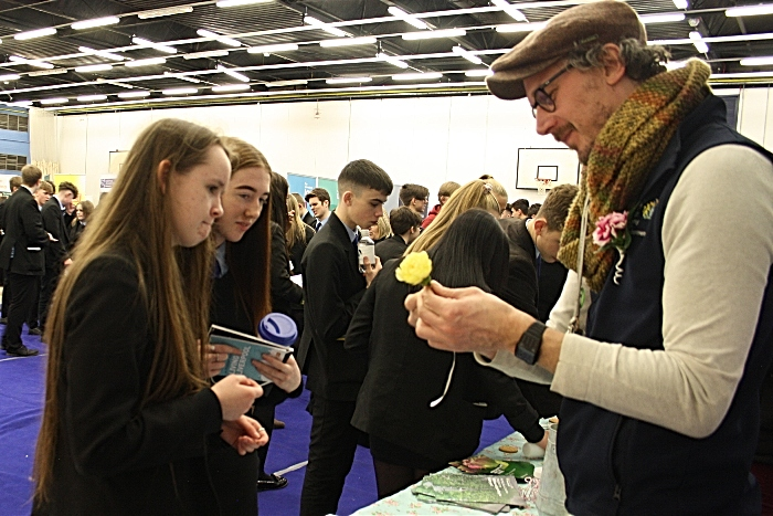 CaMadison Matravers and Leah Hadzik watch as David Billington from Reaseheath Horticultural department shows them the art of making a floral buttonhole