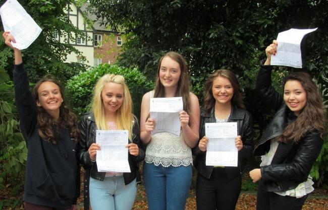 Malbank School students celebrating GCSEs