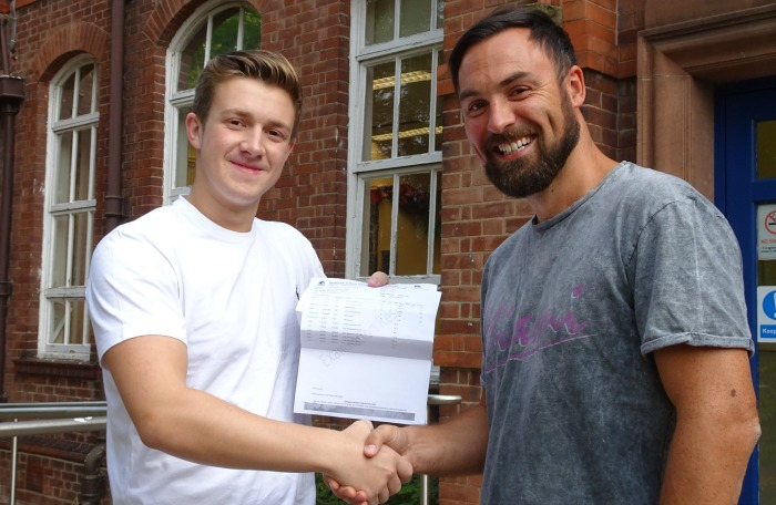 Marcus West with A level results of Malbank head of sixth form John Harrison