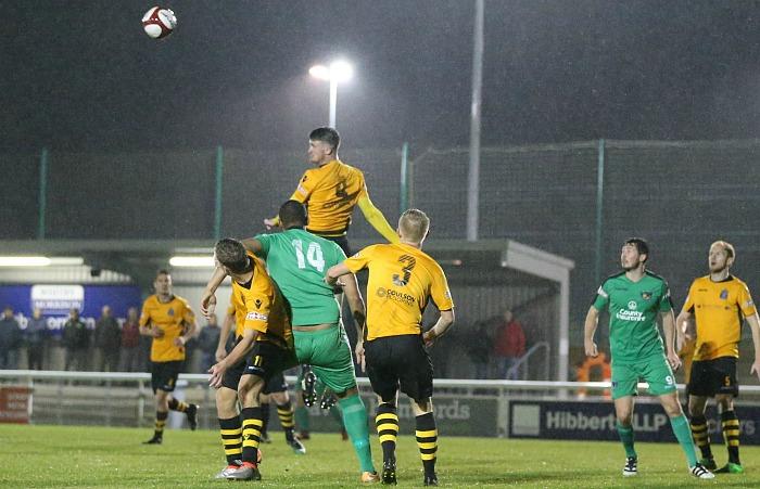 Marine midfielder Adam Hughes heads the ball clear