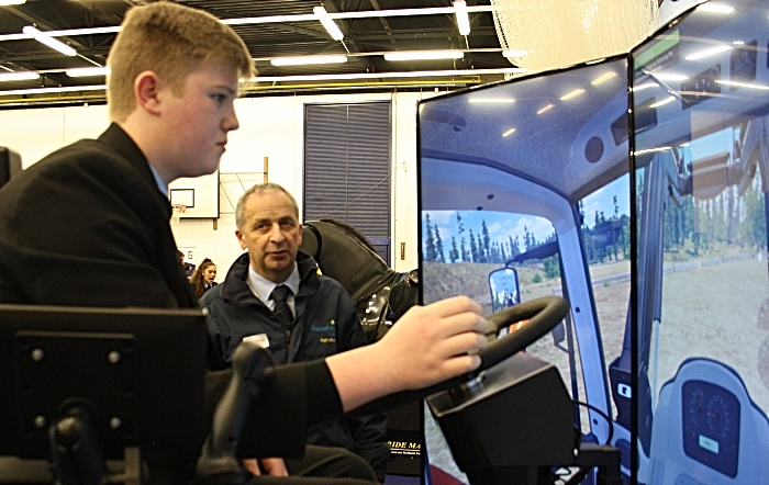 Careers - Mark Walton from Reaseheath Agricultural department watches James Brindley attentively as he tests his driving skills on the tractor simulator