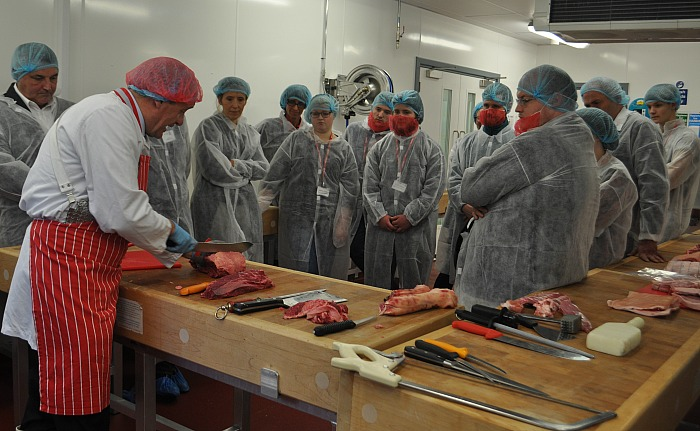butchers - Master butcher Gary Evans demonstrates knife skills to employers and apprentices