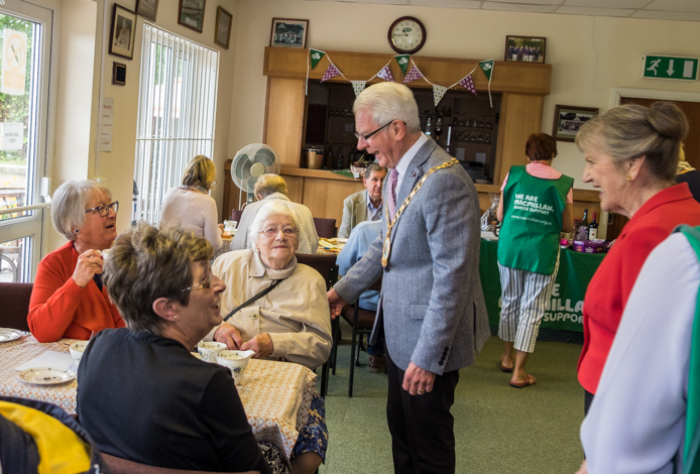 Mayor Cllr Moran chats to Macmillan Coffee morning visitors
