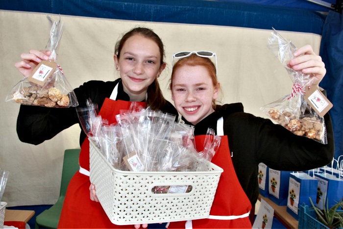 Megan Brown, 12, and Lauren Jervis, 11, selling their homemade dog treats