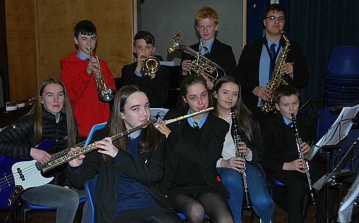 Members of the school band rehearse; they will play live at the theatre