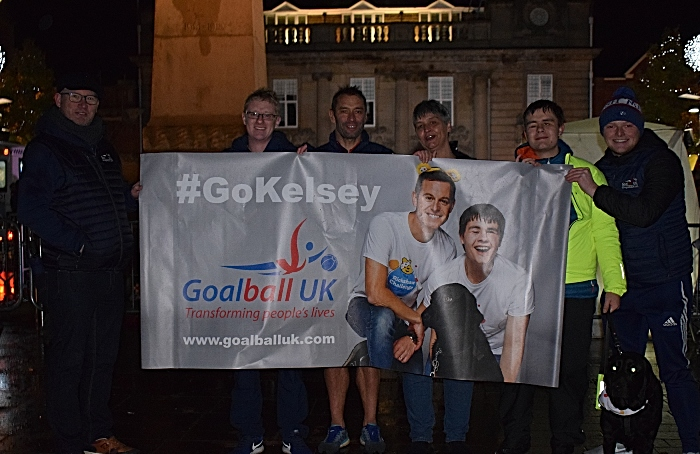 Memorial Square - Kelsey (with his guide dog) his mother and the support team from Goalball UK after Kelsey rode the Rickshaw into Crewe (1)