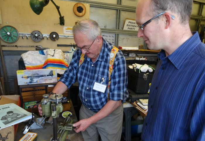 Mike Smith gives a demonstration to visitor Christopher White