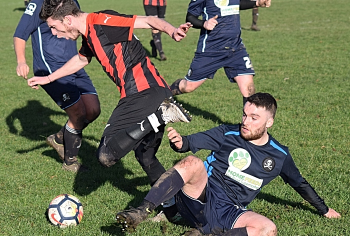 Nantwich Pirates player puts in a tackle