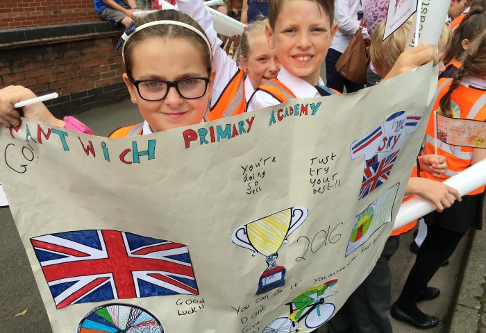 Nantwich Primary Academy pupils with posters watching tour of Britain