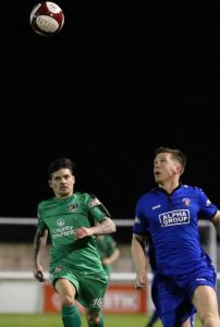 Nantwich Town Assistant Manager - player Danny Griggs and former Nantwich Town player Alex Frost eye the ball