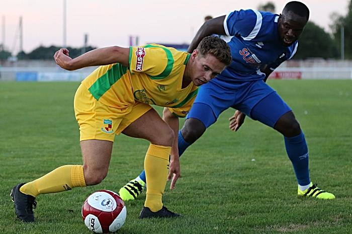 Nantwich Town eye the ball v Salford City