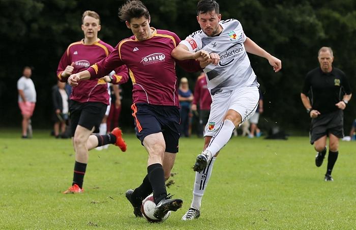 Nantwich Town player Callum Saunders shot is blocked by Wybunbury (1)