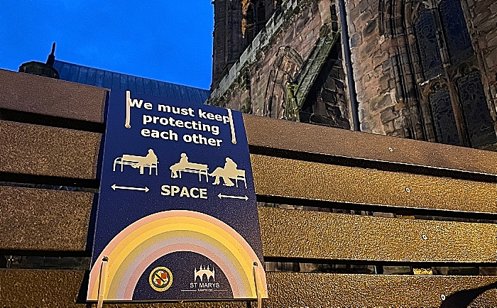 Nantwich bench with social distancing sign - outside St Marys Church (1) (1)