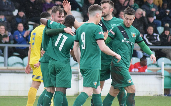 Nantwich goalscorer John Johnston celebrates with teammates against Grantham