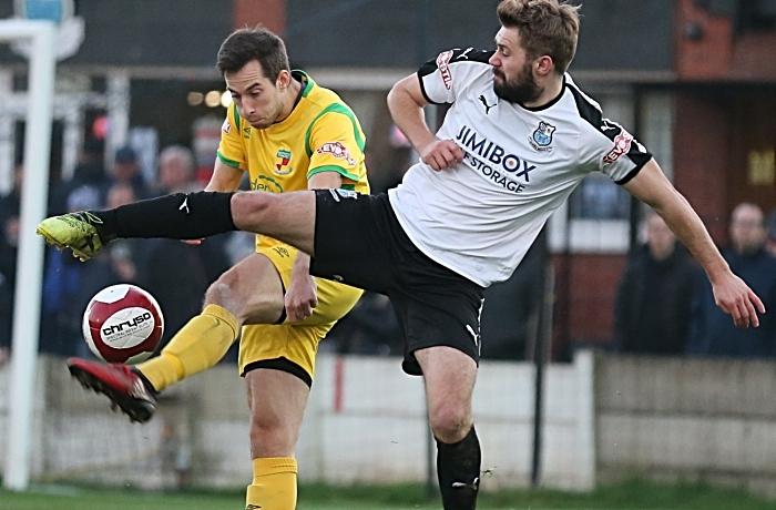 Nathan Cotterell_ kicks the ball forward under pressure (1)