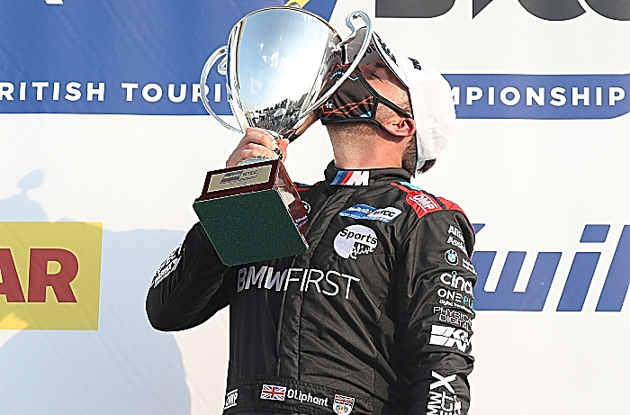 Oliphant with trophy after maiden BTCC victory at Brands Hatch