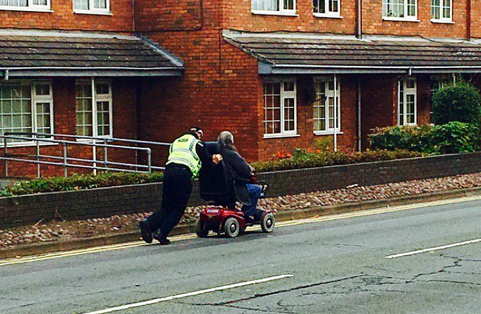 pc-marc-harley-pushed-broken-down-scooter-more-than-a-mile-home