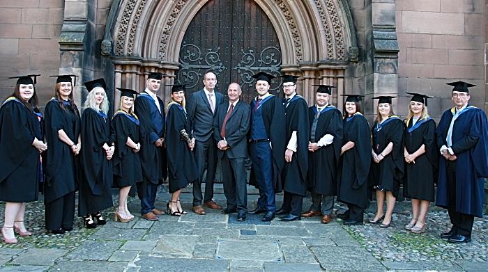 graduates outside the church