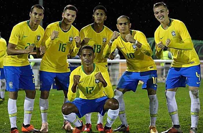 Post-match - Brazil players celebrate their win