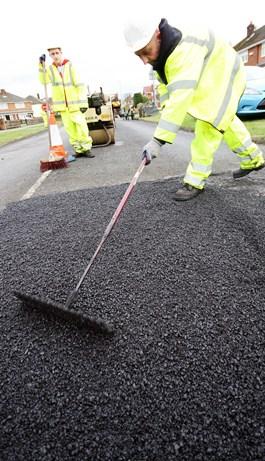 Potholes repair image - compensation