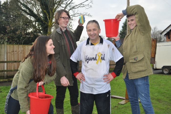 Raising money for Africa - Preparing for a soaking mark Walton with students Sam Gibbons, Alex Hutson and Matt Dudley