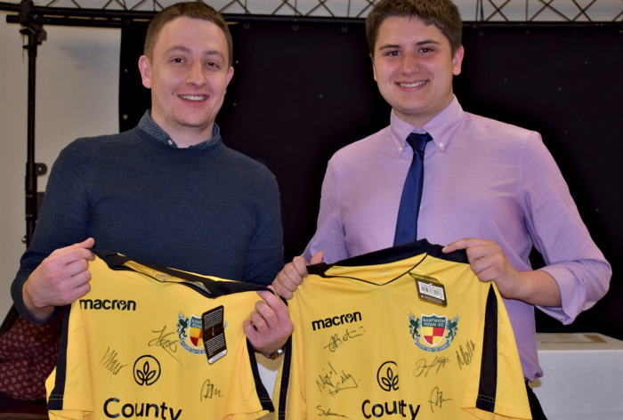 Press Officer Officer Steve Sharman - left - and Assistant Press Officer Ryan Batty receive signed shirts for their hard work over the season