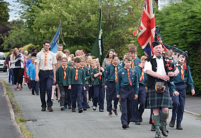 Fete - Procession led by Scottish Piper Reg Flower
