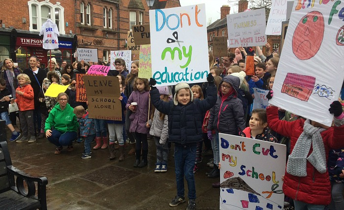 Protesting in nantwich town square, school funding cuts, timpson shop in background