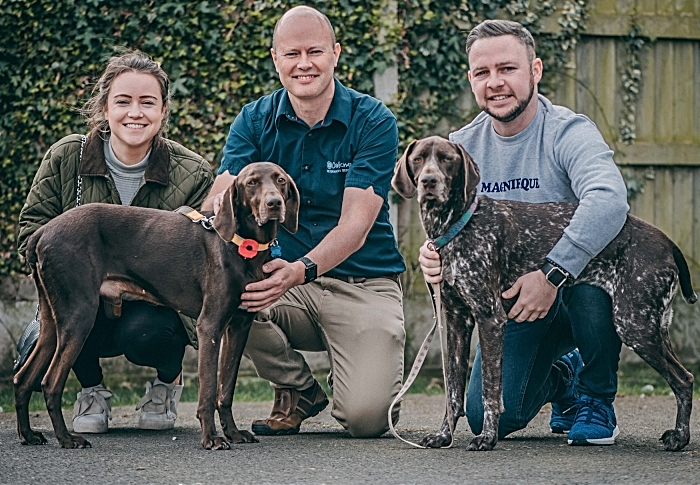 Rebecca Vickers and Alex McGreal and vet Charlie Sale(centre) with Cola (left) and the couple's other pointer Ronnie