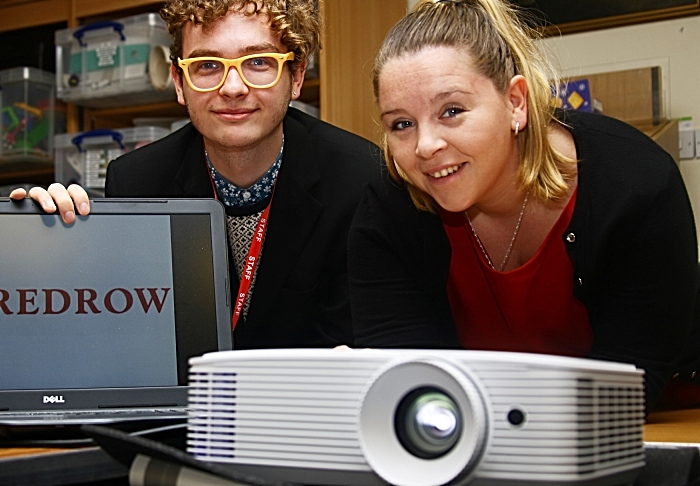 Redrow's Laura Hayward pictured trying out the new projector at Nantwich Museum with Elliot Goodger (1)