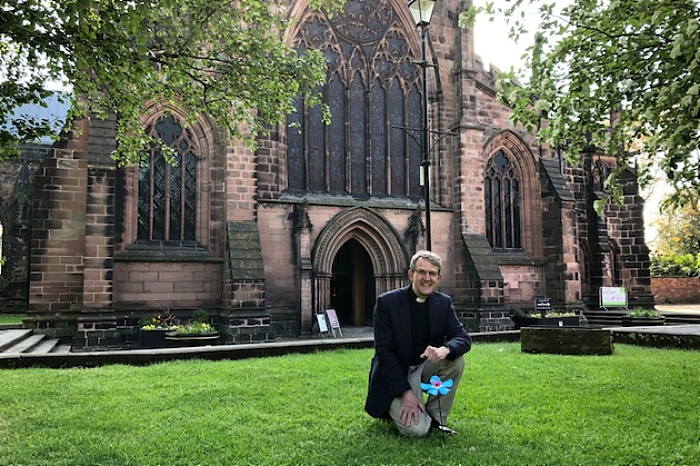 Rev Mark Hart at St Mary's Church and Forget Me Not flower